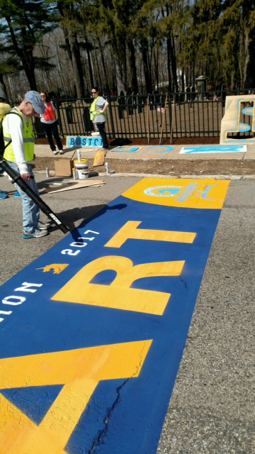 painting the starting line of the Boston Marathon